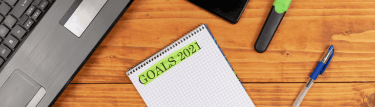 notepad on a desk with Goals 2021 written on it - list of ways operations management software can help be more proactive in 2021